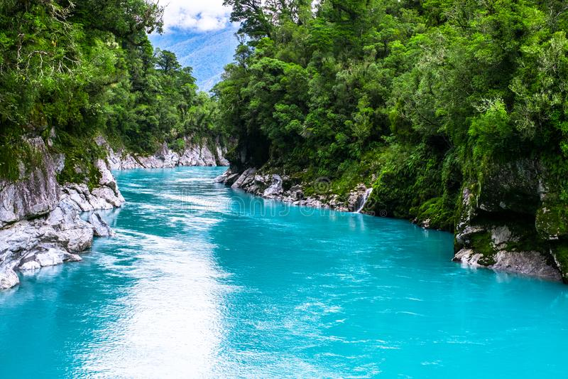 Hokitika Gorge, West Coast, New Zealand. Beautiful nature with blueturquoise color water and wooden swing bridge. I stock photos