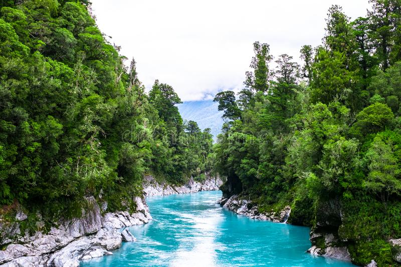 Hokitika Gorge, West Coast, New Zealand. Beautiful nature with blueturquoise color water and wooden swing bridge. I royalty free stock photo