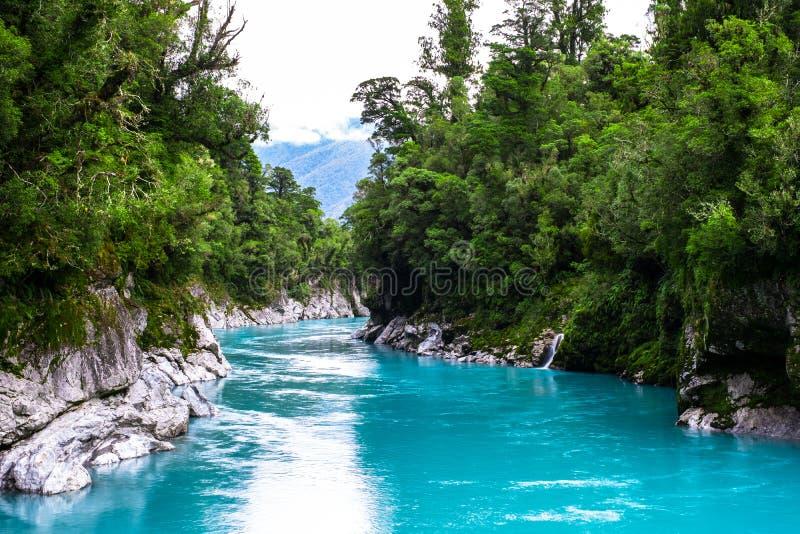 Hokitika Gorge, West Coast, New Zealand. Beautiful nature with blueturquoise color water and wooden swing bridge. I royalty free stock images