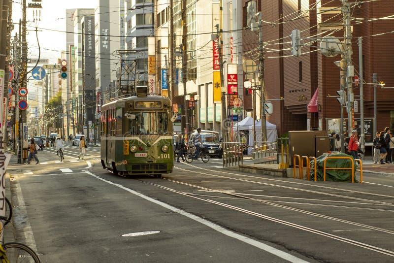 Hokkaido japan - octobor 8,2018 : old model of supporo city str. Eet car ,tram running on track ,sappora is principle city in hokkaido island northern of japan stock photo