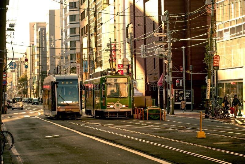 Hokkaido japan - octobor 8,2018 : old model of supporo city str. Eet car ,tram running on track ,sappora is principle city in hokkaido island northern of japan royalty free stock images
