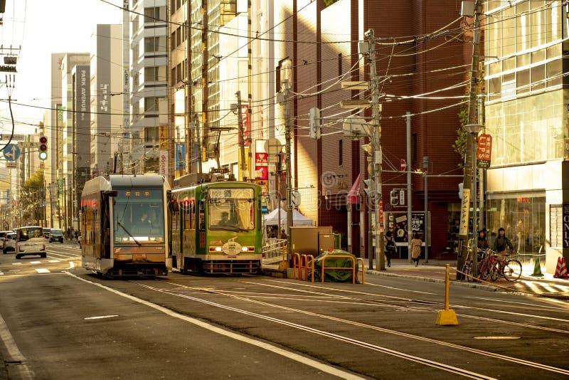 Hokkaido japan - octobor 8,2018 : old model of supporo city str. Eet car ,tram running on track ,sappora is principle city in hokkaido island northern of japan royalty free stock photo