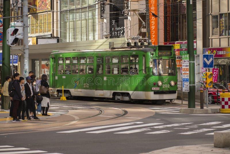 Hokkaido japan - octobor 8,2018 : old model of supporo city str. Eet car ,tram running on track ,sappora is principle city in hokkaido island northern of japan stock images