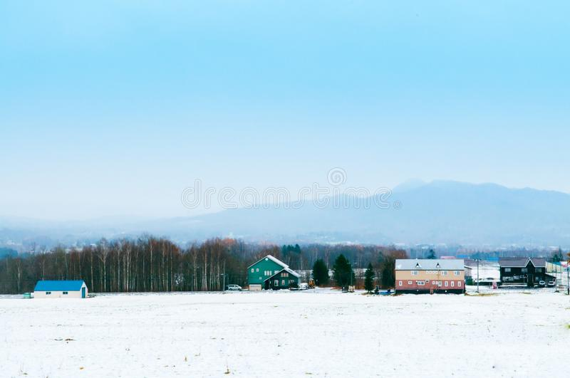 Hokkaido Mountain range on foggy cloudy day in winter with paste royalty free stock images