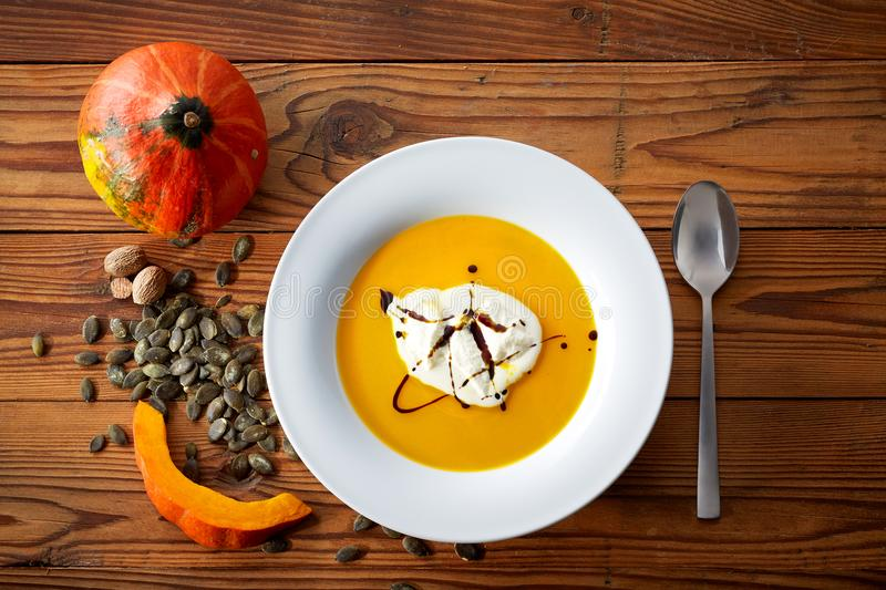 Hokkaido pumpkin soup. Stillife of pumpkin soup, decorated with pumpkin and seeds royalty free stock photography