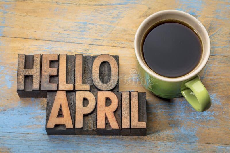 Hola extracto de la palabra de abril en el tipo de madera imágenes de archivo libres de regalías