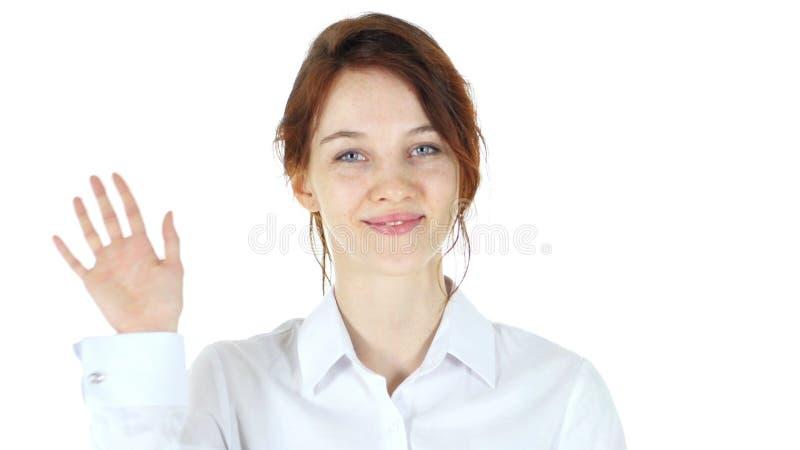 Hola, mano que agita, mujer roja del pelo imagen de archivo