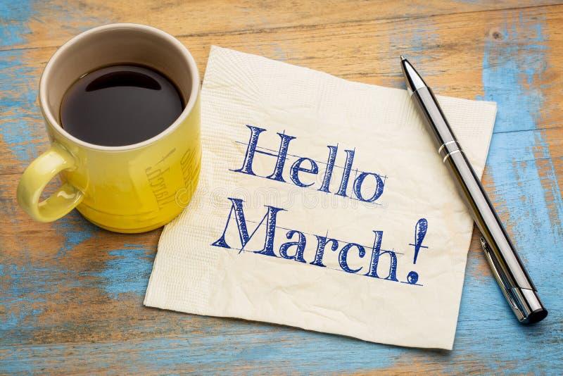 Hola marzo en servilleta imagen de archivo