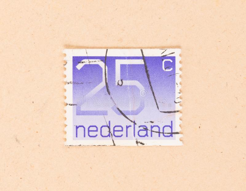 HOLANDIE 1980: Znaczek drukujący w holandii przedstawieniach ja jest wartością 25 centów około 1980, obrazy stock