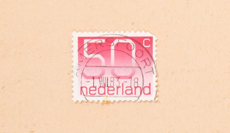 HOLANDIE 1980: Znaczek drukujący w holandii przedstawieniach ja jest wartością 50 centów około 1980, fotografia royalty free