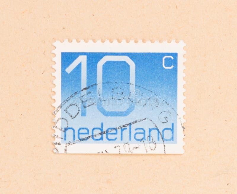 HOLANDIE 1980: Znaczek drukujący w holandii przedstawieniach ja jest wartością 10 centów około 1980, obrazy stock