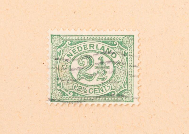 HOLANDIE 1950: Znaczek drukujący w holandii przedstawieniach ja jest wartością, około 1950 zdjęcia royalty free