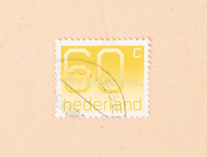HOLANDIE 1980: Znaczek drukujący w holandii przedstawieniach ja jest wartością, około 1980 obraz royalty free