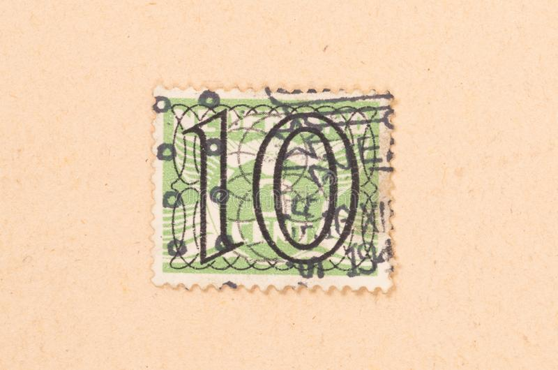 HOLANDIE 1950: Znaczek drukuj?cy w holandii przedstawieniach ja jest warto?ci?, oko?o 1950 fotografia royalty free