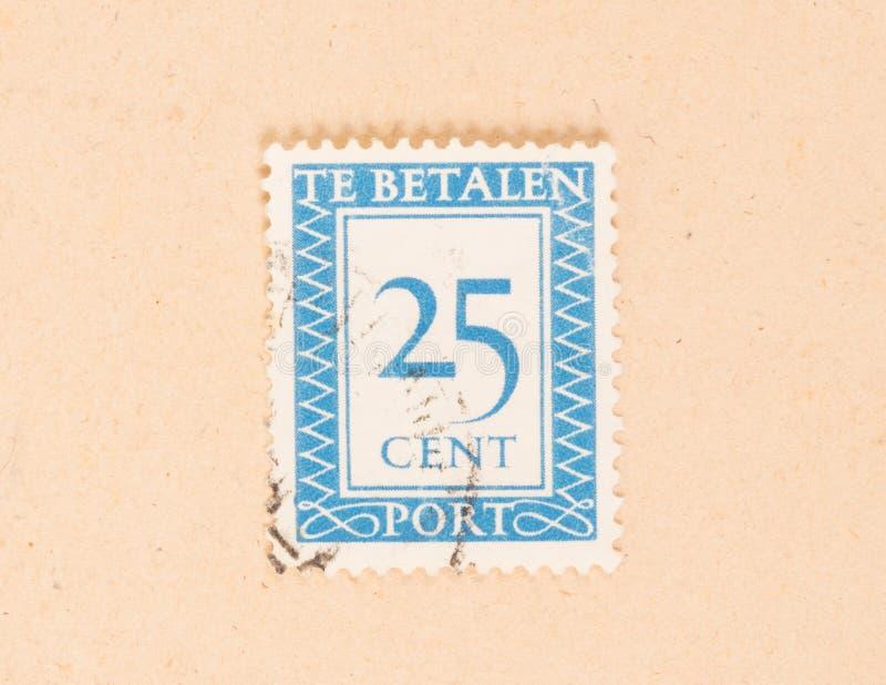 HOLANDIE 1950: Znaczek drukuj?cy w holandii przedstawieniach ja jest warto?ci?, oko?o 1950 obraz royalty free