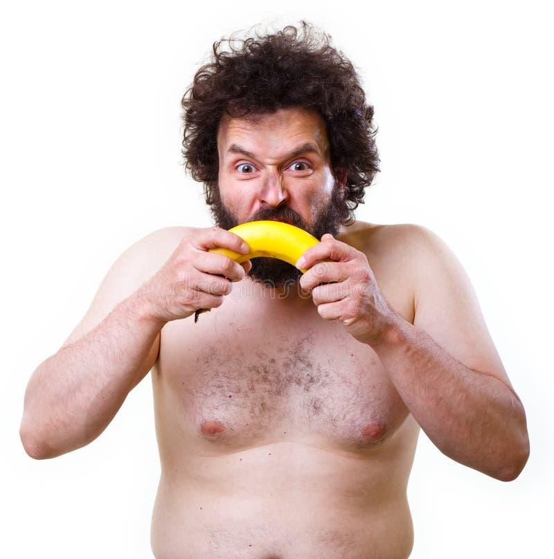Holbewoner met een banaan stock foto's
