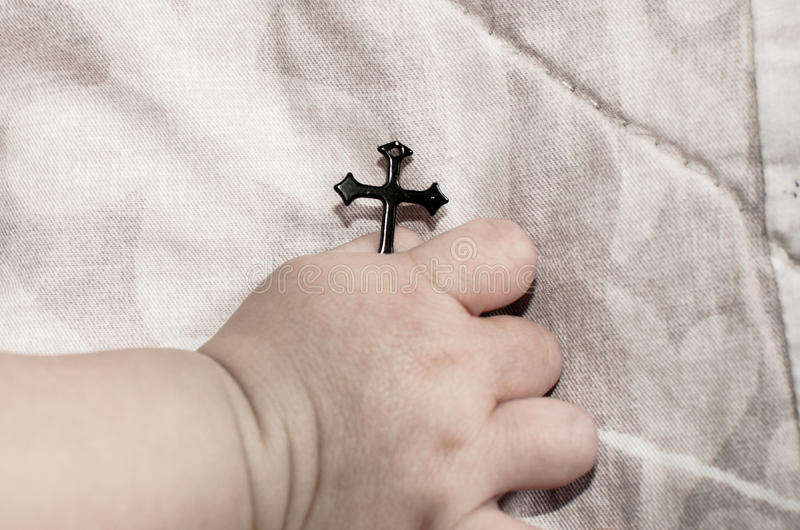 Hold the black cross. stock photos