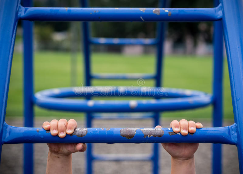 Download Hold on stock photo. Image of fingers, bars, play, playing - 33486512