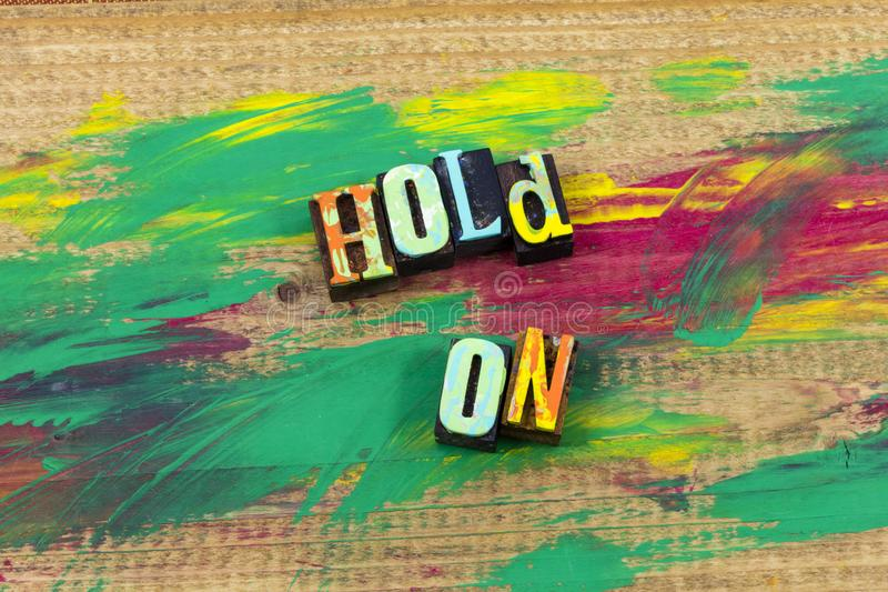 Hold on worth wait see tomorrow time letterpress quote. Hold on worth wait see tomorrow time dont delay typography phrase message procrastinate procrastination royalty free stock photo