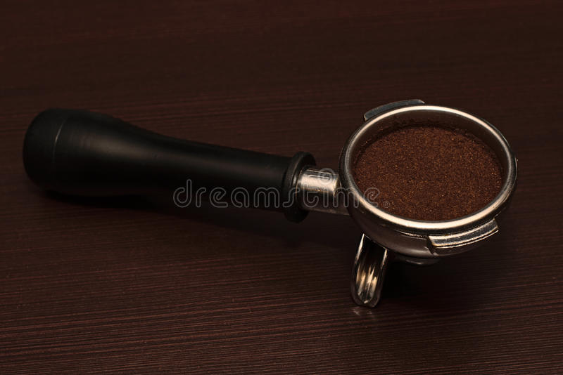 Holder of coffee machines with ground coffee stock photos