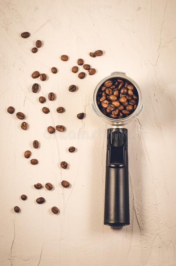 holder for the coffee maker and beans/holder for the coffee maker and beans on a concrete background. Top view royalty free stock images
