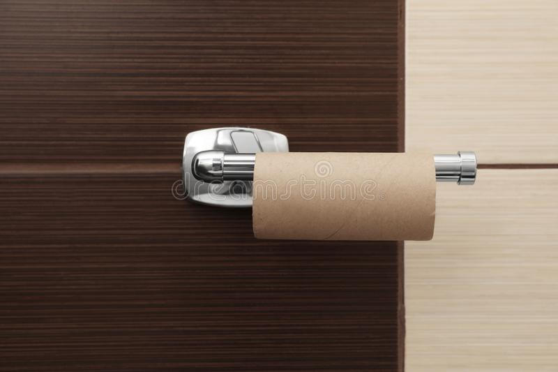 Holder with empty toilet paper roll. In bathroom royalty free stock image