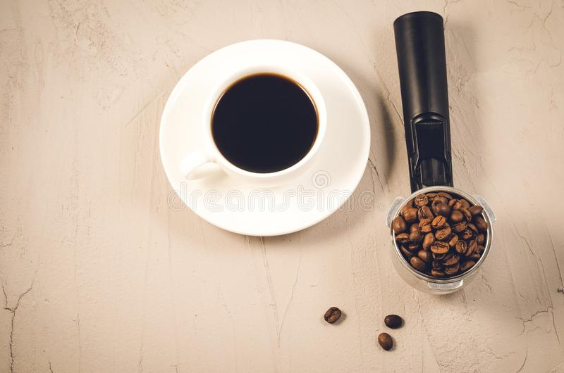 Holder filled with beans and coffee cup/holder filled with beans and coffee cup, top view stock photos