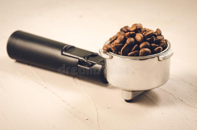holder filled with coffee beans/holder filled with coffee beans on a concrete background stock images