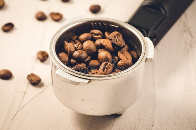 Holder filled with coffee beans/holder filled with coffee beans. Close up royalty free stock photography