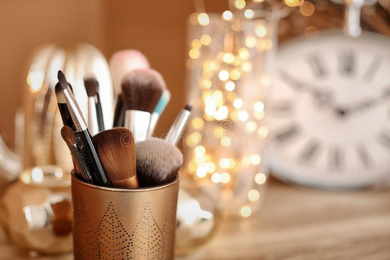 Holder with makeup brushes. Closeup royalty free stock photo