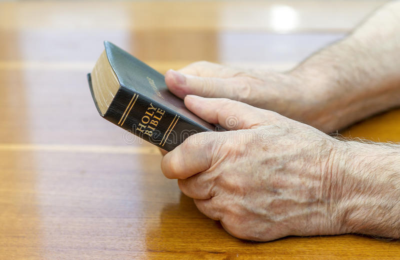 Holding the bible royalty free stock image
