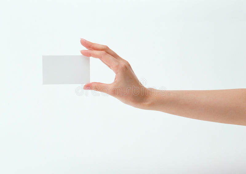 Holding blank business card. A hand reaching out and holding a blank business card stock images