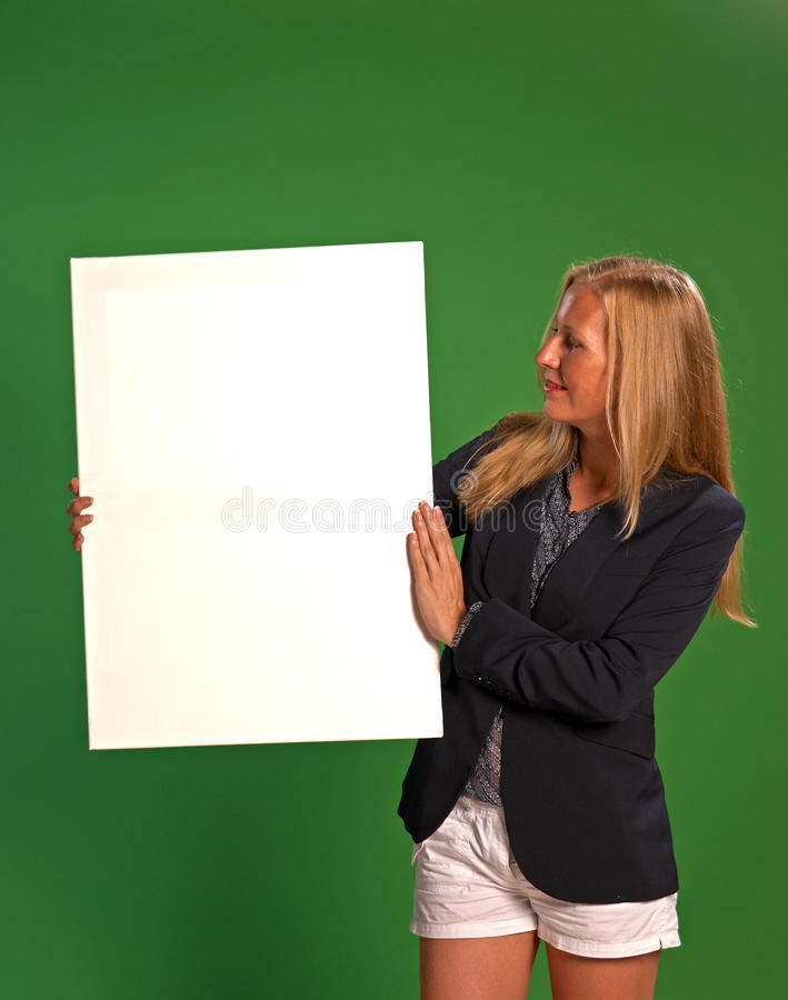 Holding a board with copy space royalty free stock photography