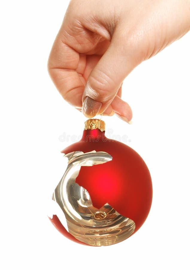 Free Holding Broken Christmas Ball Stock Image - 5147021