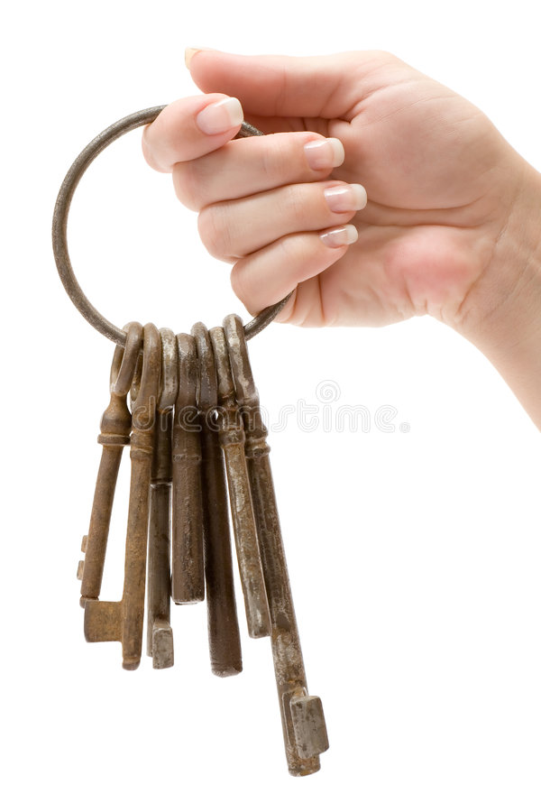 Holding a Bunch of Rusty Keys. Female hand holding a bunch of old keys. Isolated on a white background royalty free stock image