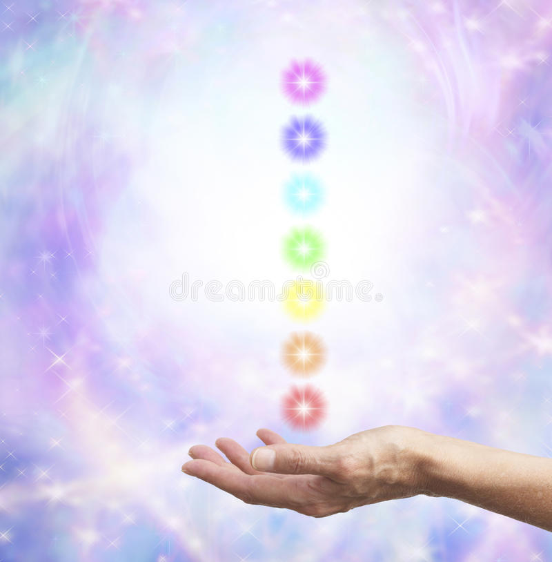 Holding chakra energy in open hand stock photo