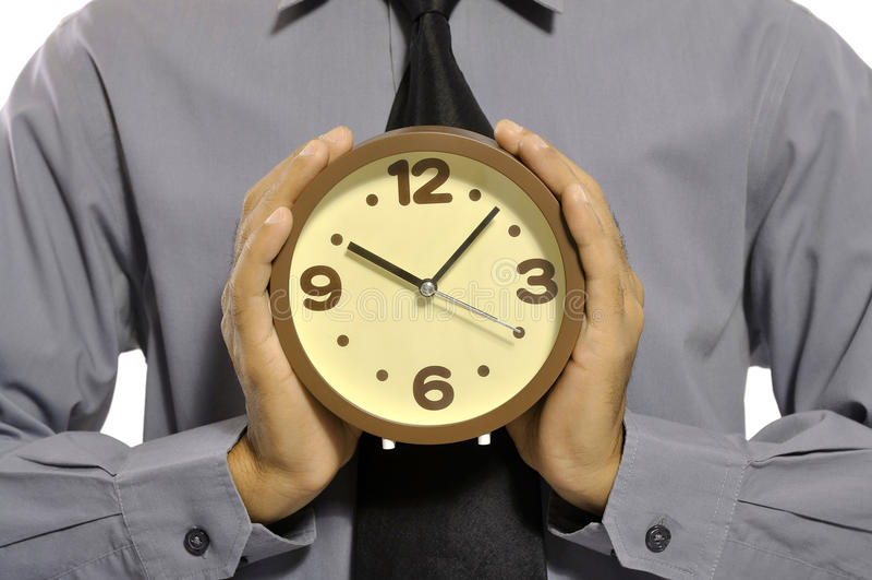 Holding Clock stock photo