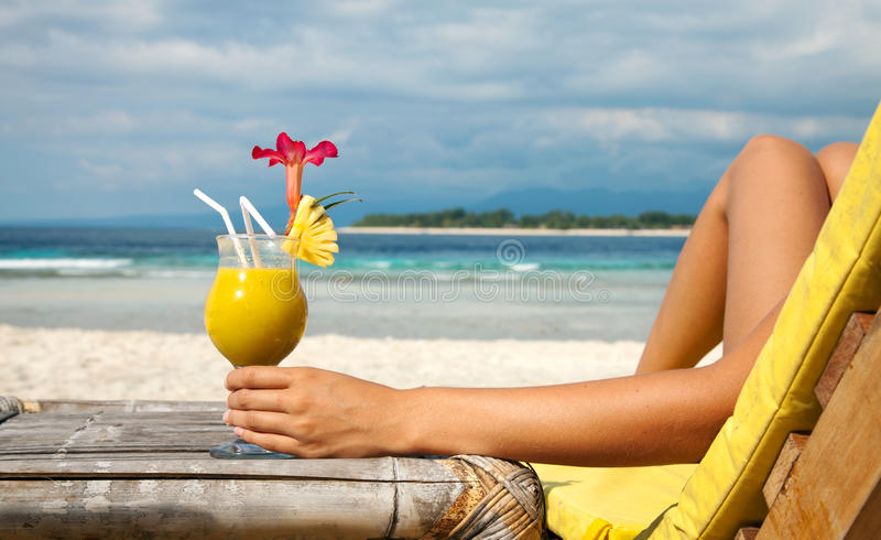 Holding A Cocktail On A Tropical Beach Stock Photos