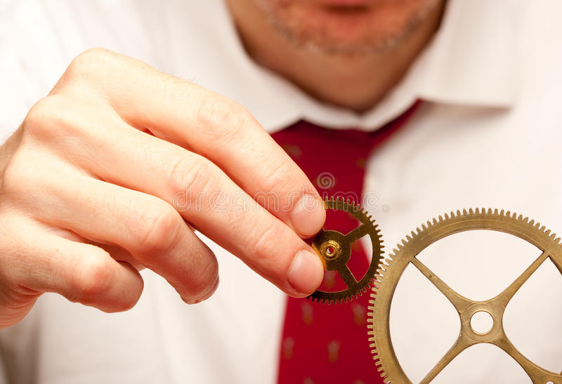Holding cogwheels stock images