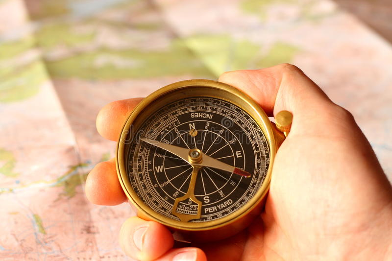 Holding compass A royalty free stock images