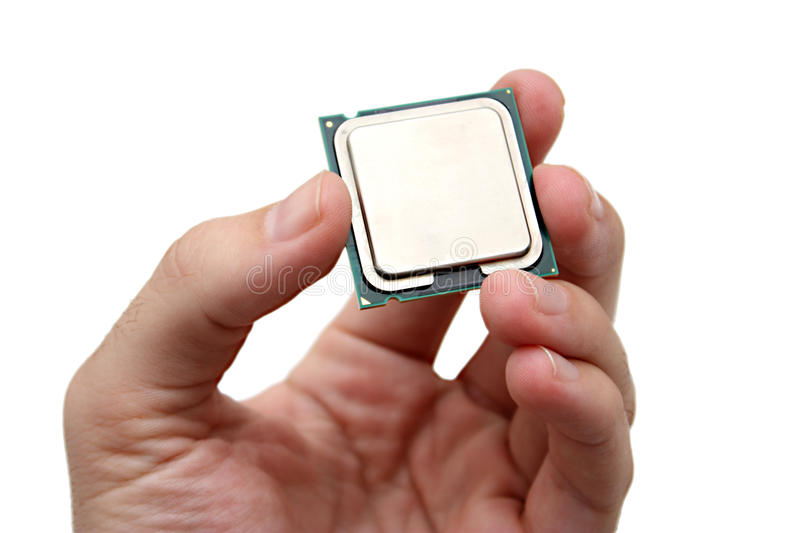 Holding a Computer Processing Unit CPU. Photo showing a hand holding a CPU royalty free stock image