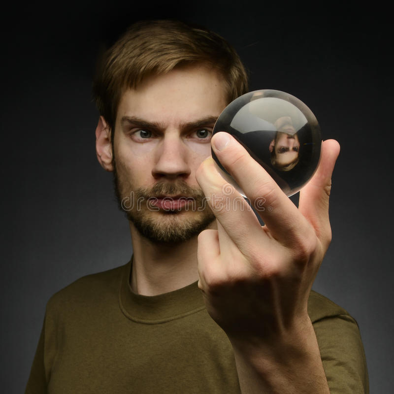 Holding a Crystal Ball royalty free stock photo