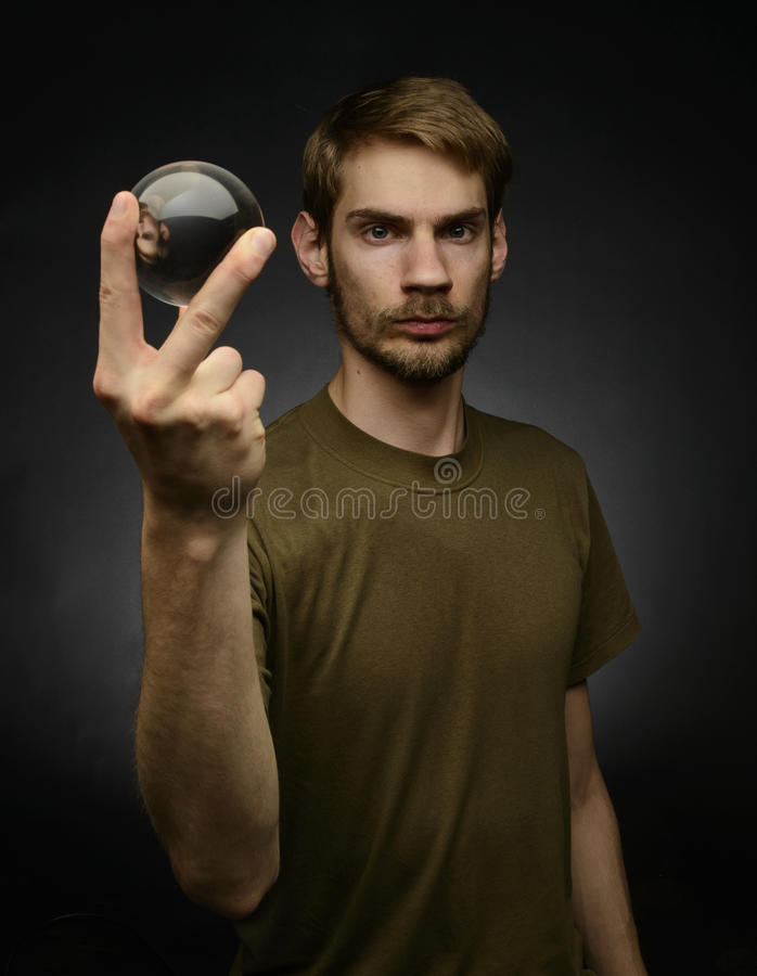 Holding a Crystal Ball stock image