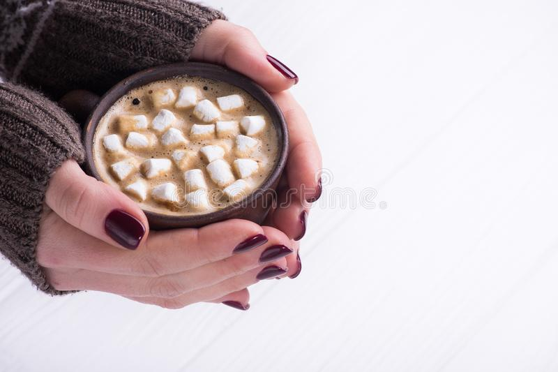 Holding cup of coffee with marshmallow stock images
