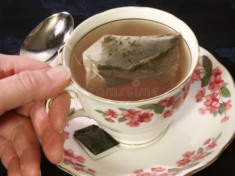 Holding A Dainty Cup Of Tea royalty free stock photography