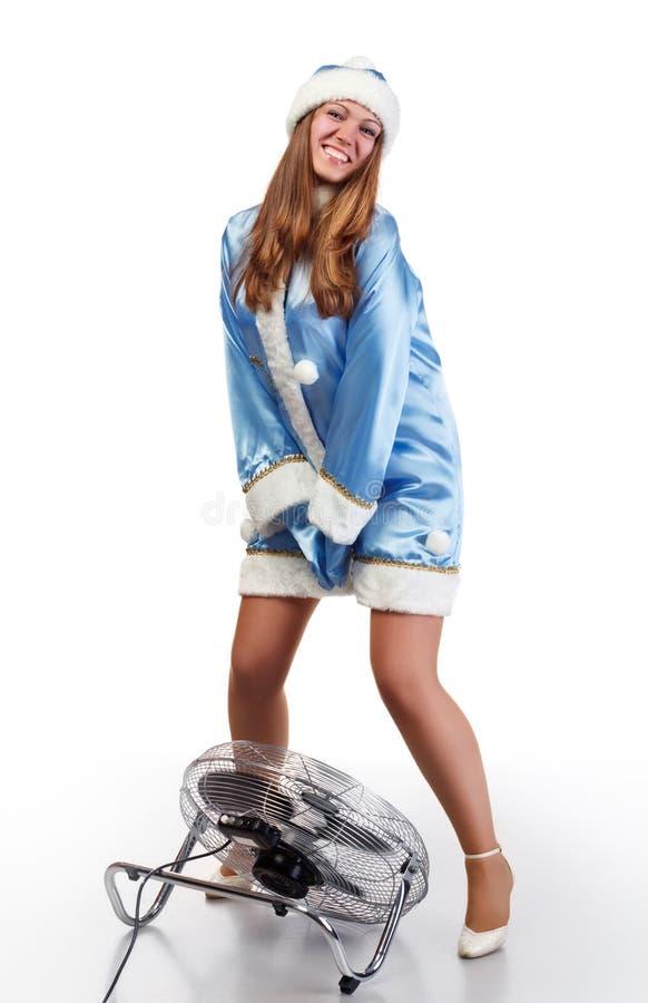 Holding della ragazza della Santa il suo pannello esterno dal colpo del ventilatore immagine stock