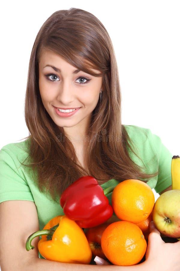 Holding della ragazza in mani in pieno della frutta differente immagini stock libere da diritti