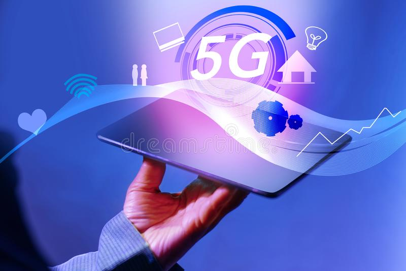 Holding Digital Tablet on 5g High Speed Network with mobile Internet. Business and new generation networks technology concept on royalty free stock photos