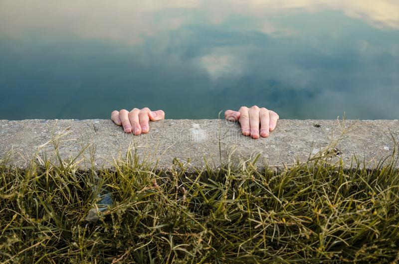 holding-edge-cliff-hands-holding-edge-cl