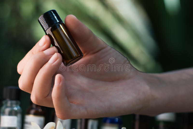 Holding essential oil bottle royalty free stock images